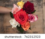 small bouquet of roses in hand... | Shutterstock . vector #762312523