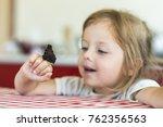 little girl holds on the hand... | Shutterstock . vector #762356563