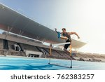 runner jumping over an hurdle... | Shutterstock . vector #762383257