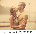 loving couple in the rain... | Shutterstock . vector #762392953