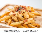 french fried melted cheddar... | Shutterstock . vector #762415237