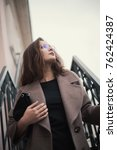 business woman walking on street   Shutterstock . vector #762424387