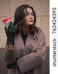 business woman walking on street   Shutterstock . vector #762424393