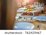women setting dining table at...   Shutterstock . vector #762425467