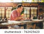men sitting in the at backyard... | Shutterstock . vector #762425623