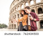 young couple at the colosseum ... | Shutterstock . vector #762434503