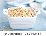 oat flakes in bowl | Shutterstock . vector #762443467