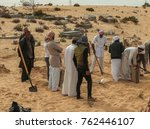 Small photo of Death toll from Egypt mosque attack rises to 305 AL ARISH, EGYPT - NOVEMBER 25: People bury victims of the of the Egypt Sinai mosque bombing in Al-Arish, Egypt on November 25, 2017.