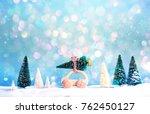 miniature wooden car carrying a ... | Shutterstock . vector #762450127