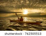 a man in a sea kayak on lake... | Shutterstock . vector #762505513
