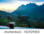 coffee cup over blurred image... | Shutterstock . vector #762529303