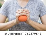 hand of woman holding stress... | Shutterstock . vector #762579643