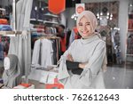 portrait of attractive asian... | Shutterstock . vector #762612643