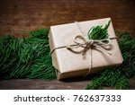 gift box wrapped with brown...   Shutterstock . vector #762637333