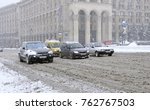 city after blizzard. cars... | Shutterstock . vector #762767503