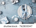 table setting with gift boxes... | Shutterstock . vector #762833347