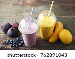 sweet smoothie in plastic cups... | Shutterstock . vector #762891043
