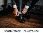 a man is wearing black shoes in ... | Shutterstock . vector #762896323