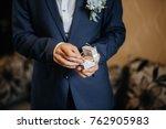the groom has a beautiful... | Shutterstock . vector #762905983