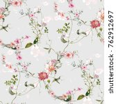 Stock photo watercolor painting of leaf and flowers seamless pattern on gray background 762912697
