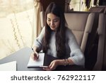 asian businesswoman is sitting... | Shutterstock . vector #762922117