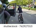 rider riding bicycle very... | Shutterstock . vector #762927313