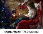 little girl at home in a... | Shutterstock . vector #762930883