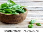 fresh baby spinach in a wooden... | Shutterstock . vector #762960073