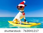 santa claus dog surfing on a... | Shutterstock . vector #763041217
