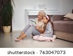 grandmother with granddaughter... | Shutterstock . vector #763047073
