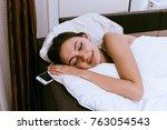 happy young girl is sleeping... | Shutterstock . vector #763054543