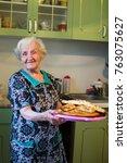 elderly woman in the kitchen... | Shutterstock . vector #763075627
