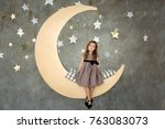 little girl in gray dress is... | Shutterstock . vector #763083073