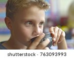 adorable little boy is drinking ... | Shutterstock . vector #763093993