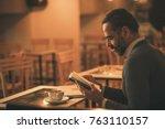 senior old man reading a book...   Shutterstock . vector #763110157