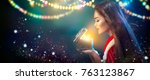 christmas winter woman opening... | Shutterstock . vector #763123867