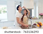 happy asian couple eating fresh ... | Shutterstock . vector #763136293
