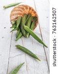 Small photo of Fresh Green Okra ( Abelmoschus esculentus ) on white wooden background