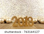 shiny 2018 numbers with golden... | Shutterstock . vector #763164127
