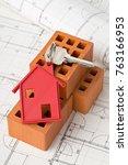 house door key with red house... | Shutterstock . vector #763166953