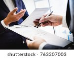 business partners discussing... | Shutterstock . vector #763207003