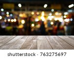 closeup top wood table with... | Shutterstock . vector #763275697