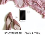 Stock photo minimal feminine background with smartphone mock up rose petals and shoes flat lay top view 763317487