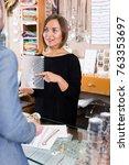 woman worker seller showing... | Shutterstock . vector #763353697