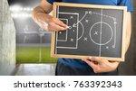 hand of a football coach... | Shutterstock . vector #763392343