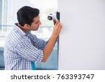 man installing surveillance... | Shutterstock . vector #763393747