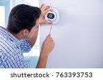 man installing surveillance... | Shutterstock . vector #763393753