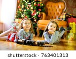 two beautiful little girls lie... | Shutterstock . vector #763401313