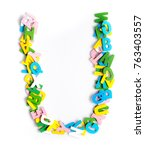 Small photo of Colorful wood alphabet letters on a white background,font letter U