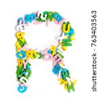 Small photo of Colorful wood alphabet letters on a white background,font letter R